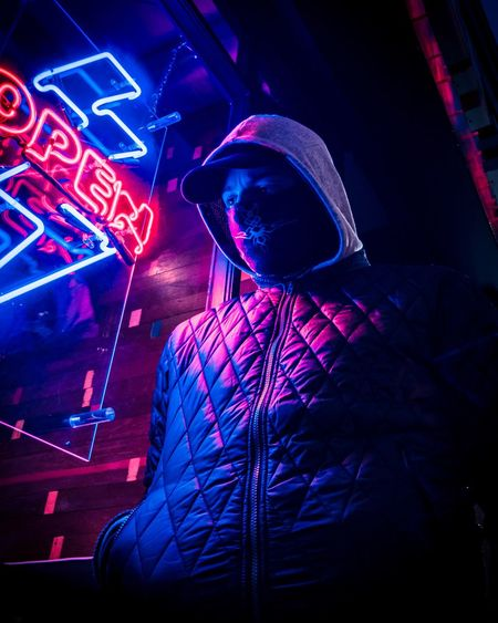 Lifestyles Neon Illuminated Night Music Nightlife Arts Culture And Entertainment Nightclub One Person Leisure Activity Waist Up Light - Natural Phenomenon Club Dj Light Performance Lighting Equipment Real People Occupation Event Dj Enjoyment Men