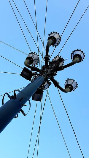 Typical Streetlamp Looking Up City Wires And Sky Blue Sky Perspective Streetlight Clear Sky Day Cable Sky Cityscape Power Cable Tall - High Urban Scene