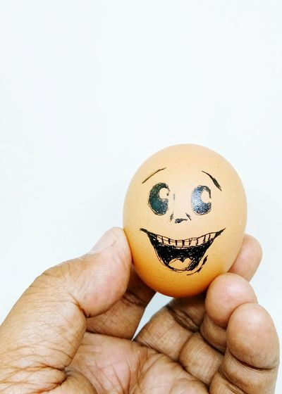 emotion happy on egg hold by man hand EyeEm Selects Happy Face Egg Concept Happy Concept Symbolic  Human Finger Human Hand Holding Anthropomorphic Smiley Face Food Close-up Indoors  Human Body Part Men