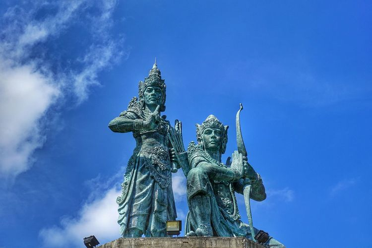 Low angle view of lord rama statue against blue sky