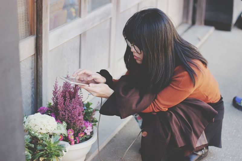 Woman Photographing Flowering Plants