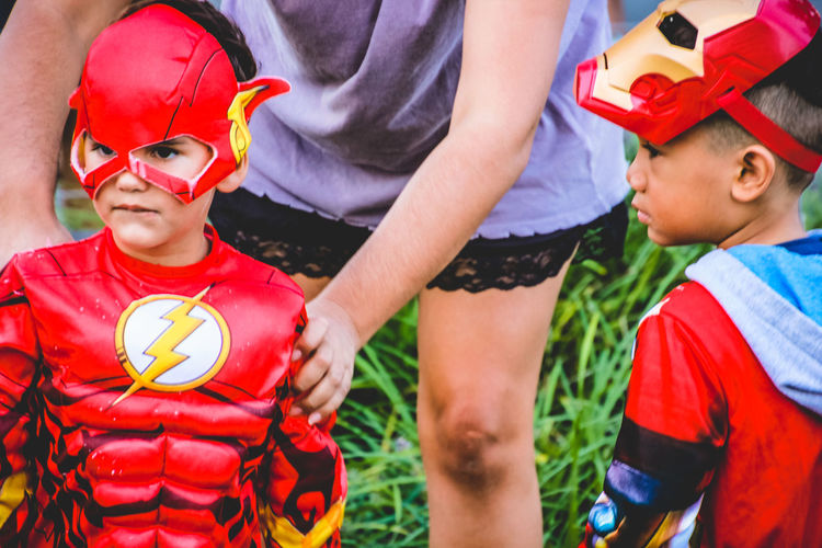 Children Mother Mother And Son Superhero Arts Culture And Entertainment Boys Character Childhood Costume Day Headwear Helmet Mask Outdoors Real People Red Safety Standing Supanova Superheroes This Is Family
