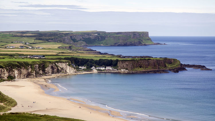 Overlooking White Park bay, Ireland Beach Beauty In Nature Blue Calm Causeway Coast Cliff Coastline County Antrim High Angle View Horizon Over Water Idyllic Nature Outdoors Scenics Sea Shore Sky Tranquil Scene Tranquility Vacations Water