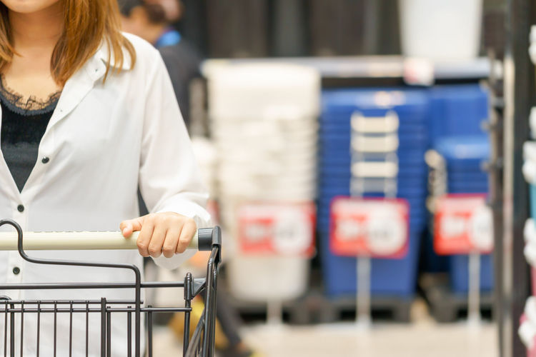 Midsection Of Woman With Shopping Cart In Supermarket