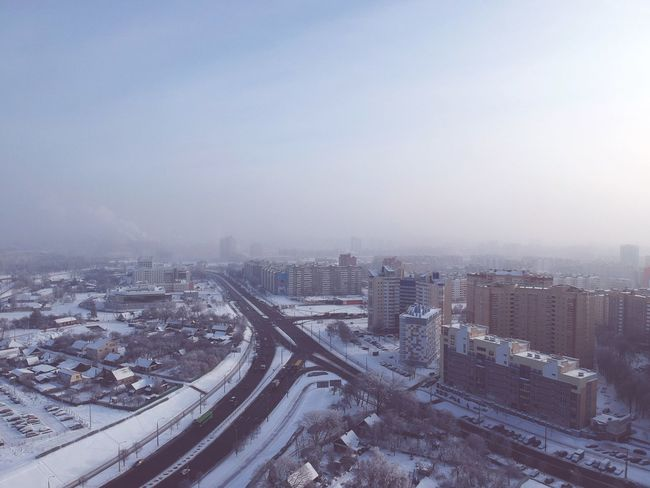 City Architecture Building Exterior Built Structure Transportation Cityscape Sky Office Building Exterior Building Winter Road Snow Aerial View Mode Of Transportation Outdoors Fog Cold Temperature High Angle View No People Nature