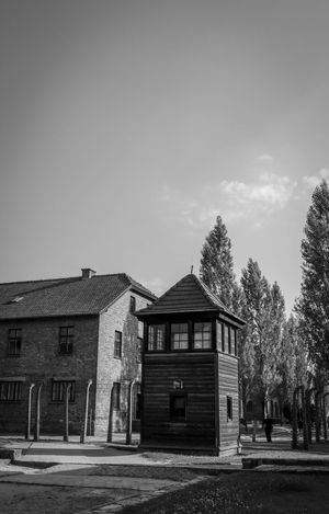 Auschwitz Auschwitz  Auschwitz Birkenau Architecture Building Exterior Built Structure Sky Building Plant Tree House Nature Day Copy Space Residential District No People Outdoors Window Cloud - Sky Entrance Old Door