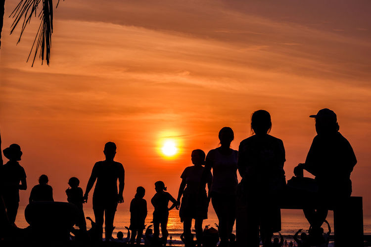Sunset Real People Group Of People Orange Color Silhouette Sky Large Group Of People Men Crowd Lifestyles Leisure Activity Sea Water Nature Togetherness Beauty In Nature Cloud - Sky Beach Horizon Over Water Outdoors Dawn Of A New Day