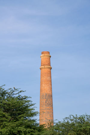 Chimney of the old ceramic factory at Praia de Chaves, Boa Vista, Cape Verde Islands Boa Vista Cabo Verdé Sal Rei Cape Verde Cape Verde Beach Ceramics Factory Chimney DISUSED Praia De Chaves Boa Vista Africa Boa Vista, Cabo Verde Boavista Cabo Verde Cabo Verde Africa Ceramics Day Disused Building Factory Industry Low Angle View No People Outdoors Sal Sky Smoke Stack Tower Tree