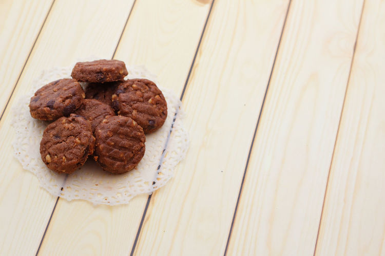 Biscuits on wooden background Biscuit Snack Time! Tea Time Chocolate Snacktime Wooden Background Food Studio Shot Dessert Homemade Wood - Material Table High Angle View Baked Sweet Food Food And Drink Brownie Sugar