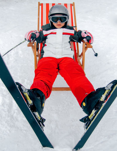 Skiing Adventure Child Childhood Cold Temperature Extreme Sports Front View Full Length Headwear Helmet Leisure Activity Lifestyles One Person Outdoors People Real People Ski Ski Goggles Ski Holiday Ski Lift Skill  Snow Sport Sunchair Warm Clothing Winter Shades Of Winter
