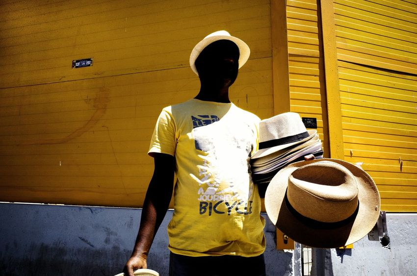Hat Vendor, Rome 2017. Paint The Town Yellow Ricoh GR II City Life Ricoh Gr2 Outdoors Streetphotography Shadow Yellow City People Rome Hats Italiastreet Italy Real People Corner Street Men
