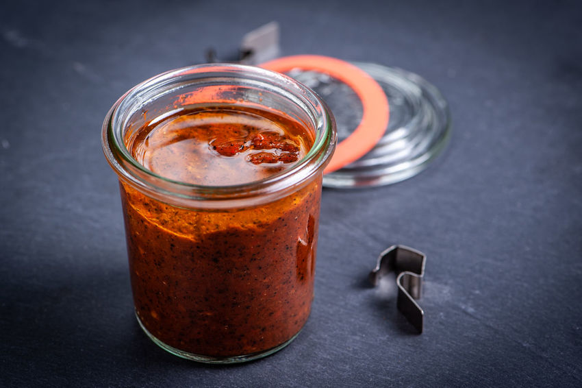 Harissa Homemade Food Spicy Chilli Close-up Cold Temperature Container Food Food And Drink Freshness Glass Glass - Material Healthy Eating Household Equipment Indoors  Jar No People Oil Orange Color Refreshment Still Life Studio Shot Table