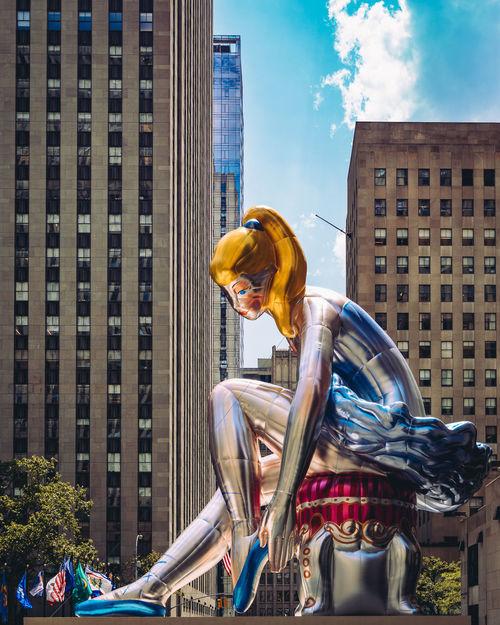 Artist Jeff Koons inflates 45-foot-high Seated Ballerina in New York's Rockefeller Center Architecture Built Structure City City Life Jeff Koons Manhattan Modern Art New York New York City NYC NYC Photography Public Art Public Art Installation Public Artwork Rockefeller Center Rockefeller Center, New York Sculpture Sky Skyscraper