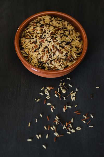 Blend of white rice, brown rice and black wild rice on dark background Rice Vegetarian Food Black Rice Brown Rice Close-up Food Food And Drink Grains Grains Of Sand Multi Grain No People White Rice Wild Rice