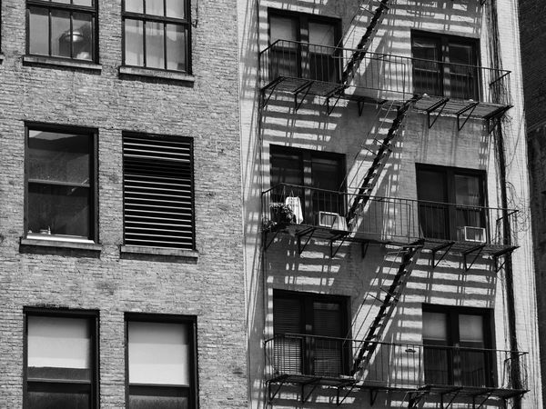 NYC Street Photography Architecture Building Exterior Built Structure Day Emergencies And Disasters Emergency Exit Fire Escape Low Angle View No People Nyc Streets Outdoors Railing Residential Building Safety Staircase Stairs Steps Steps And Staircases Urgency Window
