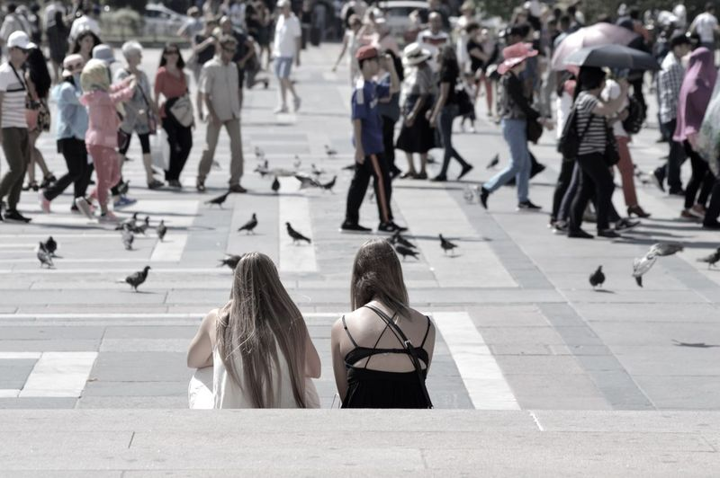 Watching the birds Watching Birds Pigeon Pigeons Girls Sitting Duomo Milan Milano Italy
