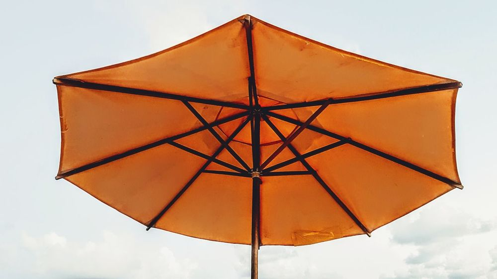 No People Outdoors Sky Summer Day Close-up Sunlight Umbrella Yellow Daylight Day Off Low Angle View Geometric Shape Beach Sealife