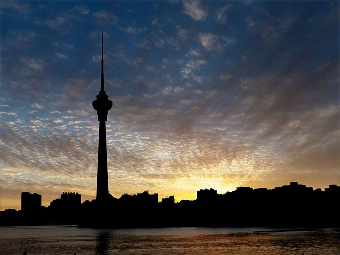 #EyeEmNewHere Sky Architecture Silhouette Building Exterior Built Structure Sunset Water Outdoors Nature Cityscape No People Travel Destinations Travel Tower Tall - High