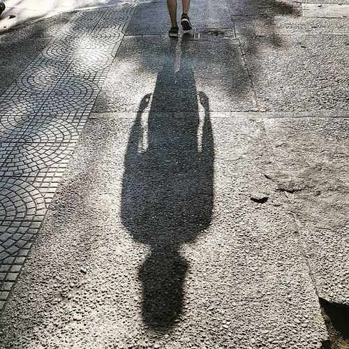 Low section of man shadow on ground