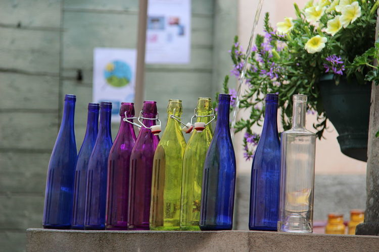 Close-up of purple flower in bottles