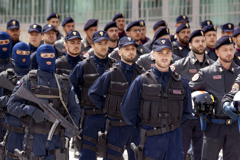 Rome, Italy - May 25, 2016: Special departments of the Italian police, deployed during the celebrations for the 164th anniversary of the State Police. Armed Deployment Uniform  Flak Jackets Guns In A Row Large Group Of People LINE Man And Woman Military Parade Police Special Forces Special Forces Police