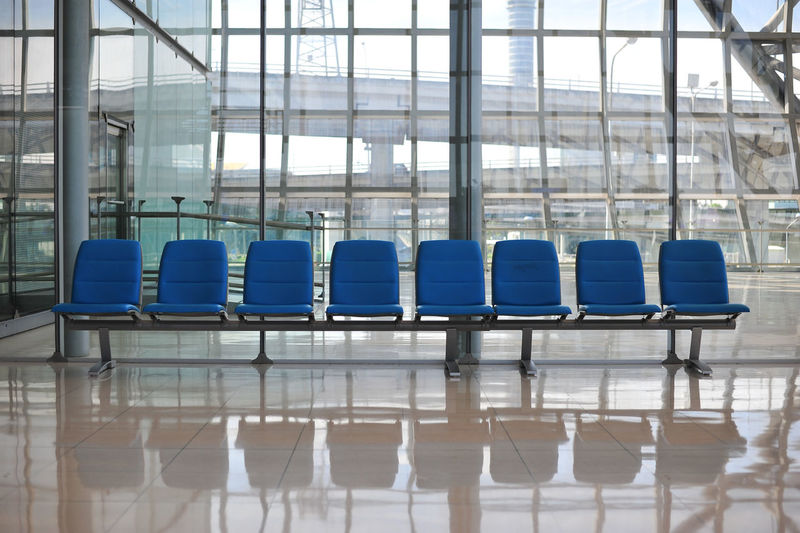 View of empty chairs at airport