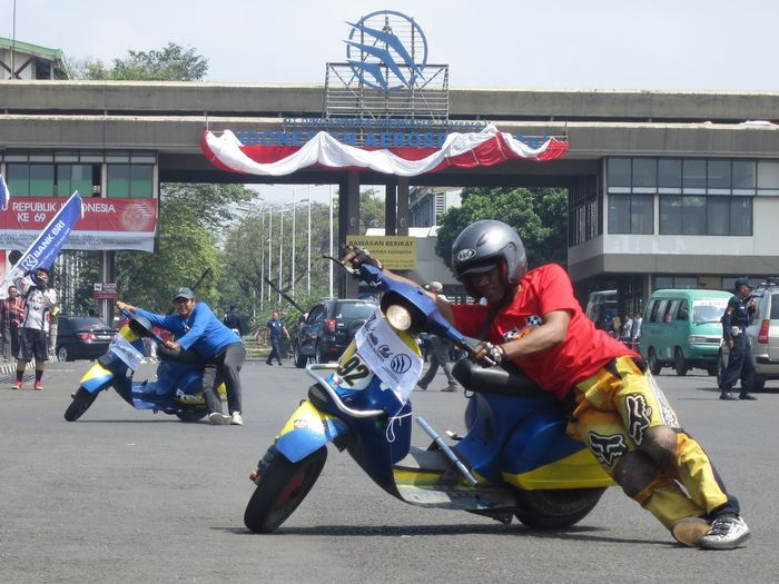 People riding motorcycle on street