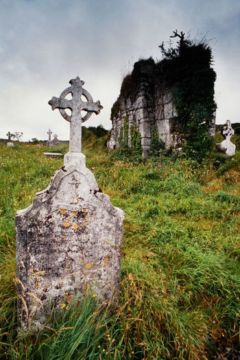 Ruin of an ancient church in Ireland Ancient Burren Church Cloudy Sky Fugacity Gloomy Gothic Gothic Architecture Gothic Style Grass Grave Graveyard Historic Historical Building Ireland Irish Landscape Medieval Medieval Architecture No People Outdoors Ruin Scenics Sky Time