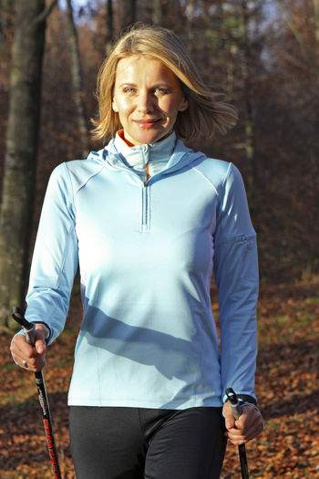 Sporty woman doing nordic walking in autumn Autumn Exercise Happy Nordic Walking Woman Activity Best Age Fit Fitness Happyness Leisure Activity Lifestyles Outdoors Sportive