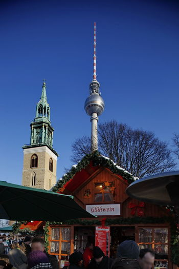 Adult Adults Only Architecture Building Exterior Built Structure Church City Clear Sky Clock Communication Day Fernsehturm / Tv Tower Glühwein Hütte Large Group Of People Men Mulled-wine Stall Outdoors People Real People Sky STAND Travel Destinations Winter