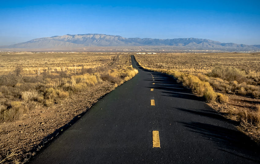 Blue Clear Sky Day Diminishing Perspective Empty Road Horizon Over Land Landscape Long Mountain Mountain Range Nature On The Road Road Road Stripes Sky Surface Level Tarmac The Way Forward Tranquility Vanishing Point Winding Road Yellow Yellow Road Stripes