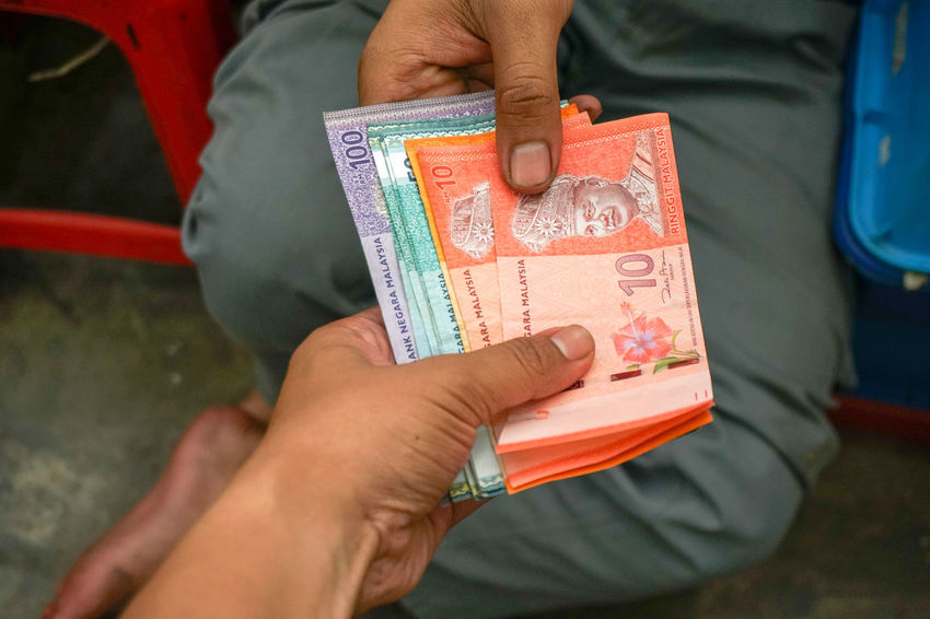 a man receiving bank note or money from other, dealing purchasing with cash Business Currency Economics Economy Modern Sale Sold Agreement Bank Banknote Business Finance And Industry Buy Cash Connection Deal Finance Finance And Economy Hand Holding Note Payment Purchase Ringgit Sell Selling
