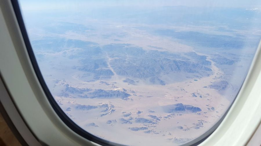 Aerial view of landscape seen from airplane window