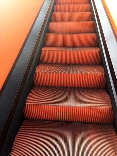 Steps Staircase Modern Steps And Staircases Indoors  High Angle View Orange Color Stairs Upstairs,downstairs Railing No People Technology Built Structure The Way Forward Close-up Futuristic Architecture Day