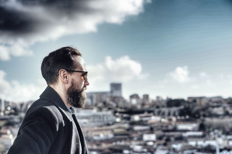 Beard Contemplation Sky One Person Real People Only Men One Man Only Cloud - Sky Headshot Leisure Activity Day Eyeglasses  Day Dreaming Portrait Outdoors Young Adult Nature People