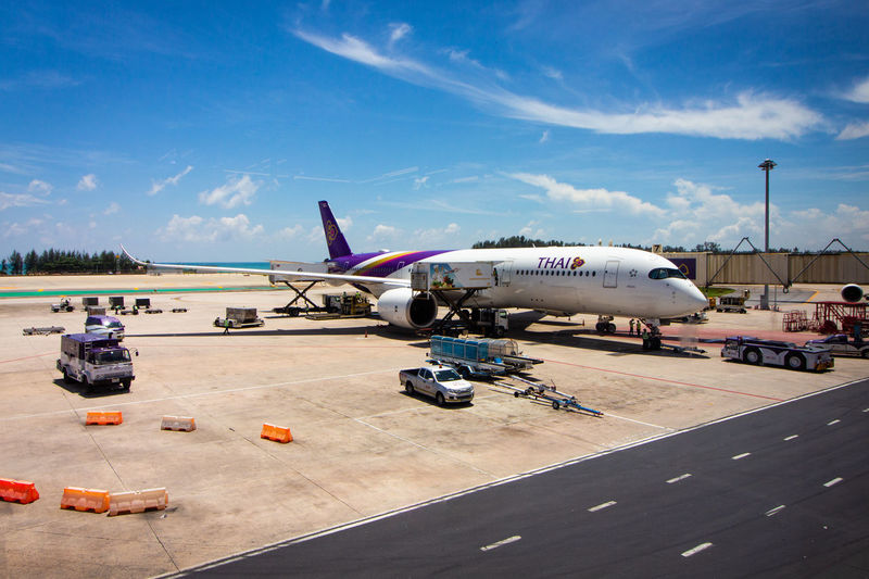 Airplane at Phuket Airport (HKT) Flugzeug Phuket,Thailand Thai Air Vehicle Aircraft Wing Airplane Airport Airport Runway Arrival Cloud - Sky Commercial Airplane Day Hkt Journey Mode Of Transportation Nature Phuket Airport Plane Public Transportation Sky Sunlight Thaiairways Travel A New Beginning