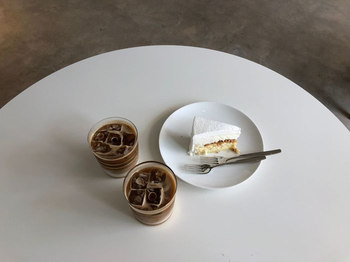 Icecoffeelatte Coffe Still Life Indoors  Table High Angle View No People Close-up Directly Above White Color Plate Shape Food Food And Drink