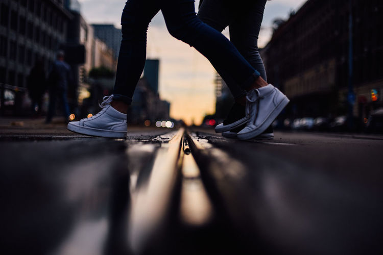 Low section of people walking on street city