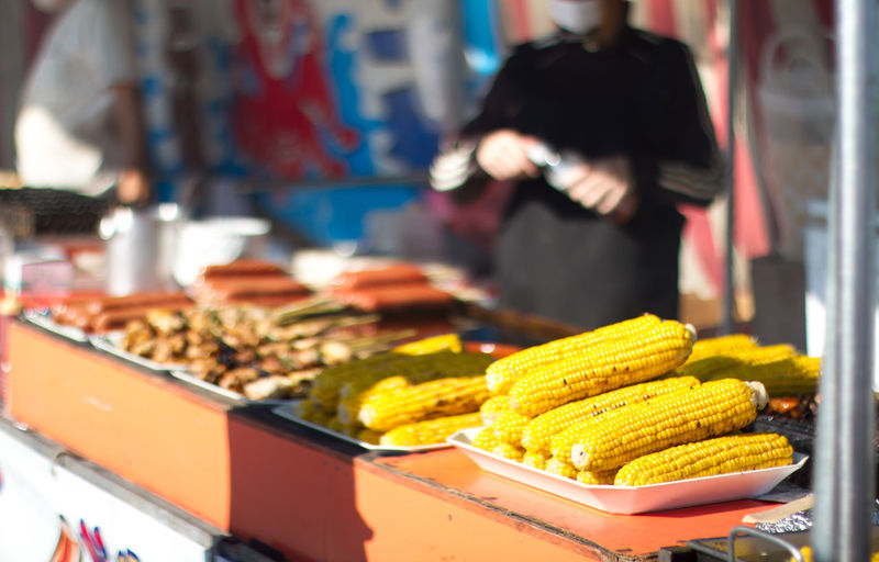 Close-Up Side View Of Corn Cobs On Display