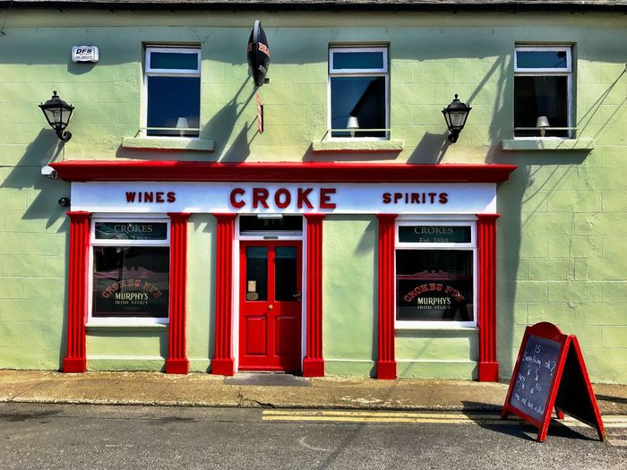 Ireland Waterford Tramore Bar Alarm Cover Lampshades Sandwich Board Spirits Wines Red Door Yellow Lines Lamps Irish Pub Pub CROKE Bar Building Exterior Architecture Red Text Built Structure Outdoors Day No People first eyeem photo