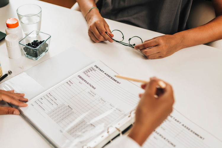 Dietary assessment form. female nutritionist working with a client