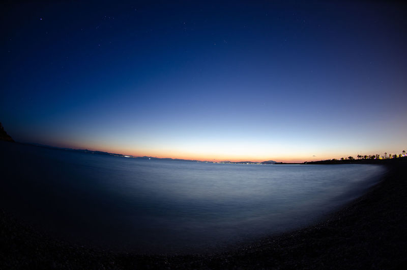 Sea and sky afternoon Sky Water Tranquility Scenics - Nature Tranquil Scene Blue Night Nature No People Land Beauty In Nature Sea Beach Twilight Horizon Star - Space Clear Sky Environment Dusk Dark Astronomy Tourist Destination Tourism
