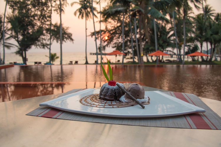 Chocolate dessert at the pool Chocolate Dessert Koh Kood Thailnd Close-up Day Dessert Focus On Foreground Food Food And Drink Freshness Healthy Eating Nature No People Outdoors Plant Plate Ready-to-eat Sweet Sweet Food Table Temptation Tree Water