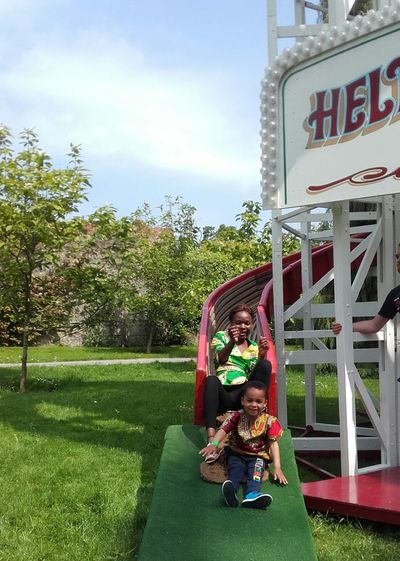 Essence Of Summer Mother And Son Slide Fun Time