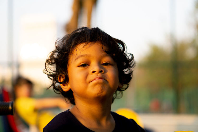 Portrait Childhood Headshot Child Focus On Foreground One Person Innocence Day Close-up Cute Men Front View Boys Real People Looking Away Males  Casual Clothing Looking Outdoors Hairstyle