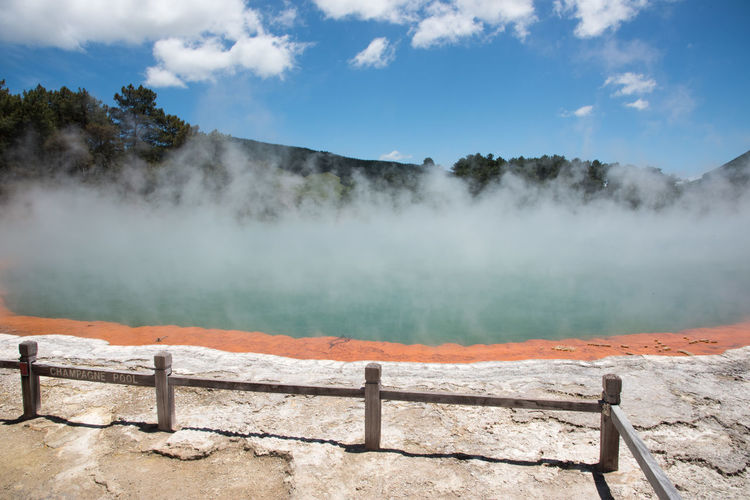 Rotorua,North Island/New Zealand-December 16, 2016: Stunning turquoise Champagne Pool at Wai-o-tapu geothermal area in Rotorua, New Zealand Rotorua  Tourist Attraction  Turquoise Colored Champagne Pool Environment Geology Geyser Heat - Temperature Hot Spring Landscape Nature New Zealand No People Non-urban Scene Outdoors Physical Geography Pool Power In Nature Railing Scenics - Nature Sky Smoke - Physical Structure Steam Volcanic Landscape Water
