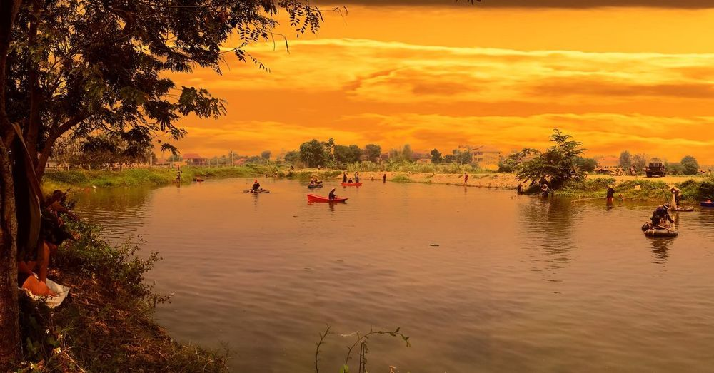 Sunset River Nature Tree Outdoors Cultures Full Length Water Vacations Living Organism People Charity And Relief Work