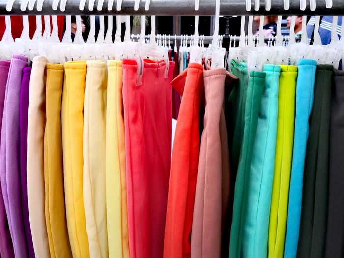 Close-up of multi colored skirts hanging at clothing store