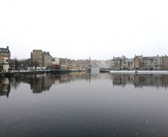 The Shore in the snow. Cityscape Snow Snow ❄ Edinburgh Scotland Cloud - Sky Boat Boats Water Waterfront HuaweiP9 Reflection Water No People Outdoors Sky Built Structure Day City