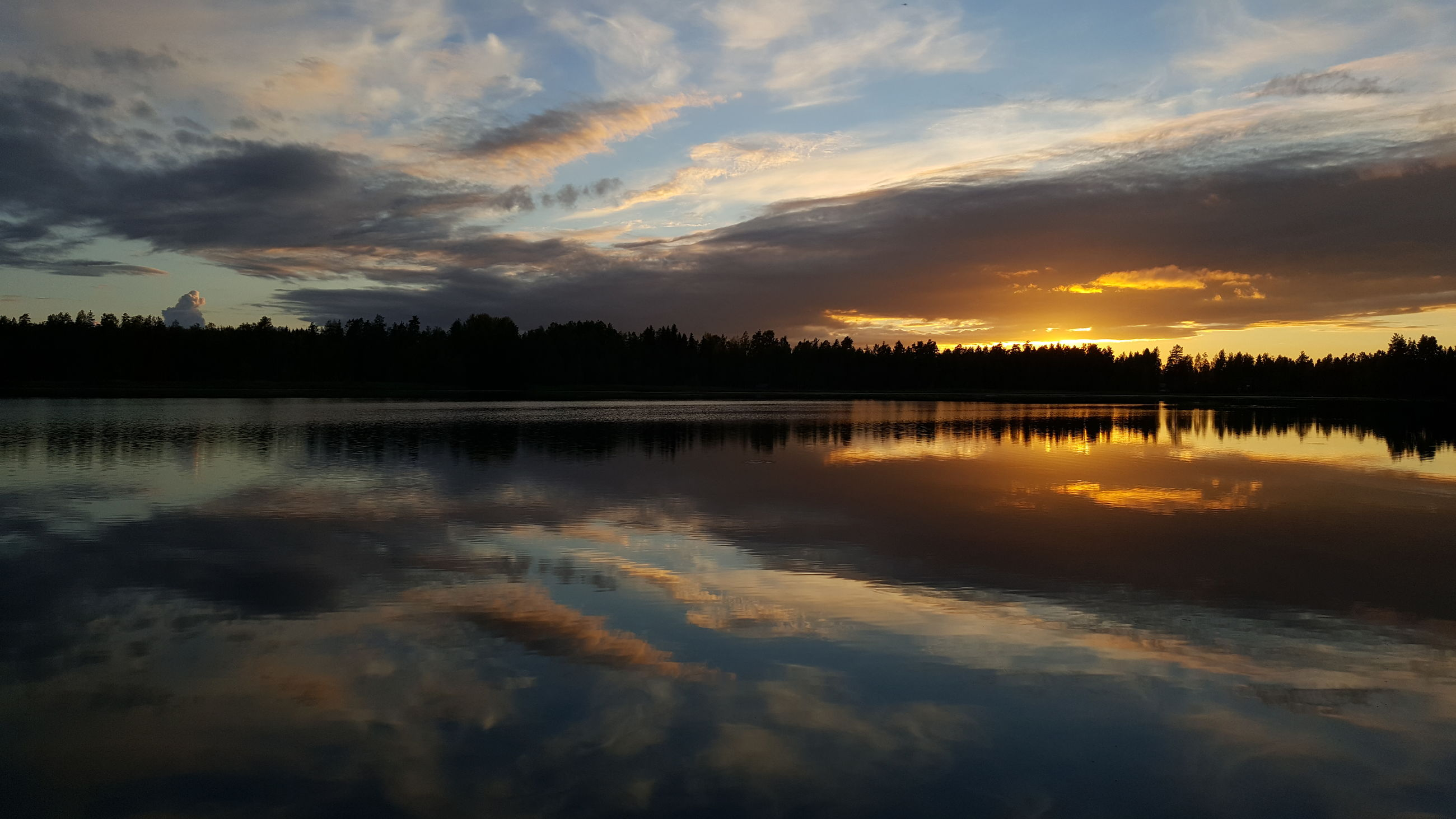 sunset, reflection, cloud - sky, sky, water, beauty in nature, nature, scenics, tranquil scene, silhouette, tranquility, no people, outdoors, tree, lake, day